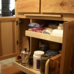 Cookie sheet bay and slide-outs share one cabinet